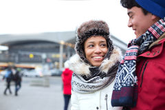 Couple Talking While Walking In City During Winter Stock Image