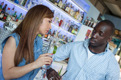Couple talking. Young couple talking at the bar Royalty Free Stock Photos