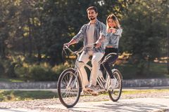 Couple with a tandem bicycle royalty free stock photos