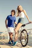 Couple with tandem bicycle resting outdoors Stock Images