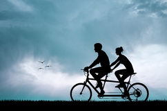 Couple in tandem Royalty Free Stock Photography