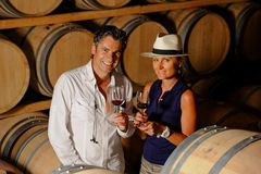 Couple tasting wine in a cellar. Tourism - Couple tasting wine in a cellar Stock Images