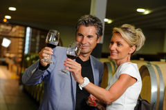 Couple tasting wine in a cellar. Tourism - Couple tasting wine in a cellar Royalty Free Stock Photos