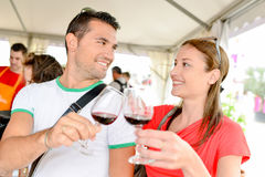 Couple tasting wine at event. Couple tasting wine at an event royalty free stock images