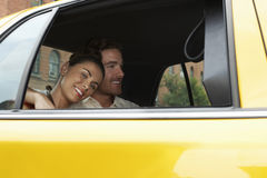 Couple in Taxi Royalty Free Stock Photo