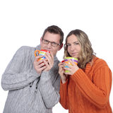Couple with tea cups Stock Images