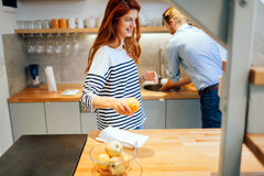 Couple teamworking in kitchen Royalty Free Stock Photography