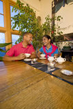 Couple with Teapot Stock Image