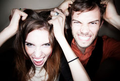 Couple tearing out their hair Royalty Free Stock Images