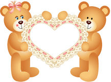 Couple Teddy Bear holding Embroidered Heart Royalty Free Stock Photography