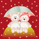 Couple teddy bear with umbrella under the rain of hearts Royalty Free Stock Images