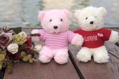 couple teddy bears picnic in garden Stock Photo