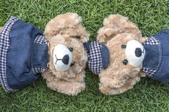 Couple teddy bears rest on lawn. Two teddy bears relax in garden, love and friendship concept Royalty Free Stock Photography