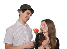 Couple of teen flirting. Smiling teen boy flirting with girl, isolated on white royalty free stock image