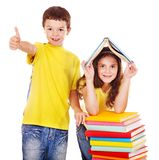 Couple of teen people. Couple of teen school child with book. Isolated royalty free stock photos