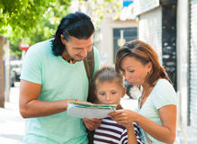 Couple with teenage boy looking at the map Royalty Free Stock Photography