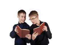 A couple of teenage boys reading books Royalty Free Stock Photos