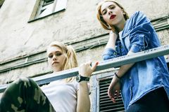 Couple of teenage girls ouyside on streets chilling, lifestyle p Royalty Free Stock Photography