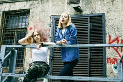 Couple of teenage girls ouyside on streets chilling, lifestyle p stock photos