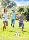 Couple and teenager boy playing with soccer ball Stock Photography
