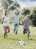 Couple and teenager boy playing with soccer ball Royalty Free Stock Photos
