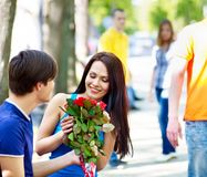 Couple of teenager on date outdoor. Royalty Free Stock Photos