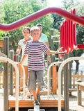 Couple  with teenager overcoming the obstacle course Royalty Free Stock Photography