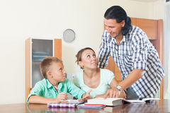 Couple with teenager schoolboy doing homework Stock Image