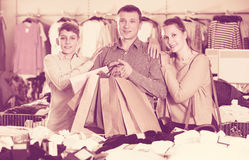 Couple and teenager with shopping bags Royalty Free Stock Photography
