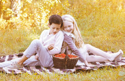 Couple teenagers with basket on the plaid in autumn Stock Photography