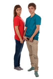 Couple of teenagers in color clothes Stock Images