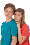 Couple of teenagers in color clothes Stock Photo