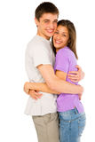 Couple of teenagers embracing. On white background Stock Photos