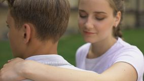 Couple of teenagers embracing each other, first love, tender relationship, youth stock video