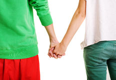 Couple of teenagers holding hands. Against white background Stock Image