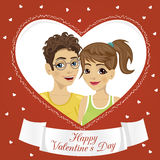 Couple of teenagers inside a heart shaped frame. Happy Valentine`s Day text on ribbon Royalty Free Stock Photography