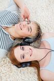 Couple of teenagers listening to music Stock Photography