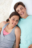 Couple of teenagers lying on the floor Stock Photo