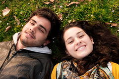 A couple of teenagers lying in the grass Stock Photo