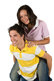 Couple of teenagers in piggyback Stock Image
