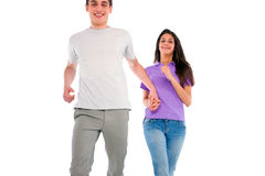 Couple of teenagers running. On the white background Royalty Free Stock Photography