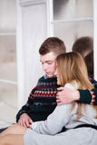Couple of teenagers sitting against mirror wall. Photo of Couple of teenagers sitting against mirror wall royalty free stock photos