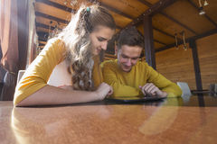 Couple of teenagers in a summer cafe Stock Photography