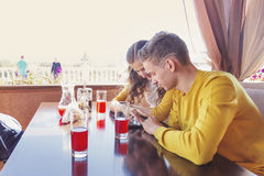 Couple of teenagers in a summer cafe Royalty Free Stock Photography