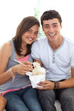 Couple of teens eating Chinese food Stock Image