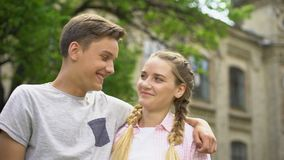 Couple of teens making selfie, first kiss, feelings of embarrassment, pure love. Stock footage stock video footage