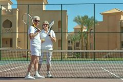 Couple on tennis court Stock Images