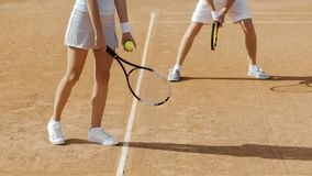 Couple of tennis players preparing to serve ball, sports competition, closeup. Stock photo royalty free stock photo
