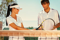 Couple of tennis players Stock Images