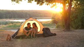 Couple in a tent on nature stock video footage